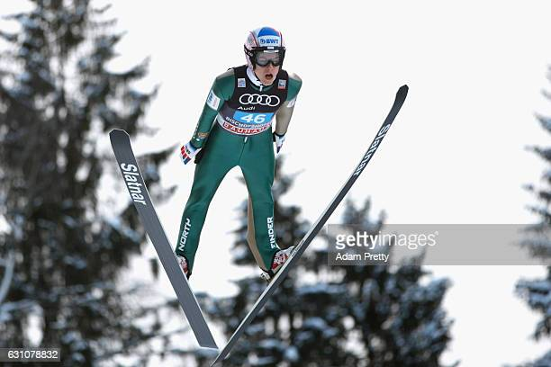 Tomas Vancura of Czech Republic competes at the trail round on Day 2 of the 65th Four Hills Tournament ski jumping event at PaulAusserleitnerSchanze...