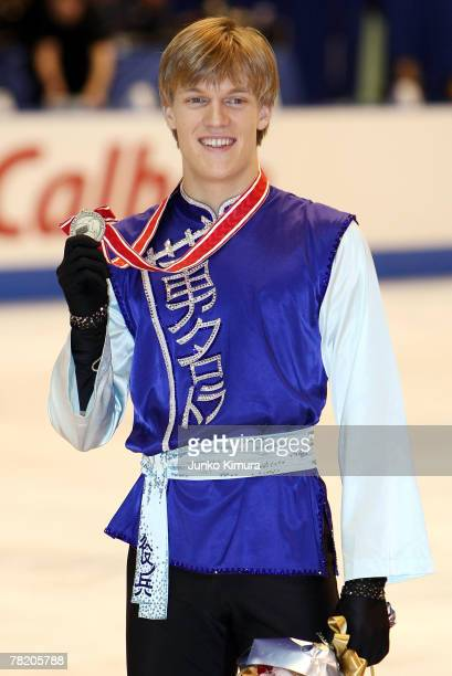Tomas Verner of Czech Republic who won silver in men's competition of the ISU Grand Prix of Figure Skating NHK Trophy poses for phtoographers at...
