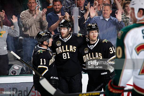 Tomas Vincour Derek Roy and Philip Larsen of the Dallas Stars celebrate a goal against the Minnesota Wild at the American Airlines Center on March 29...