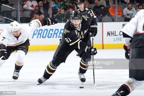 Tomas Vincour of the Dallas Stars handles the puck against Andrew Cogliano of the Anaheim Ducks at the American Airlines Center on February 8 2013 in...