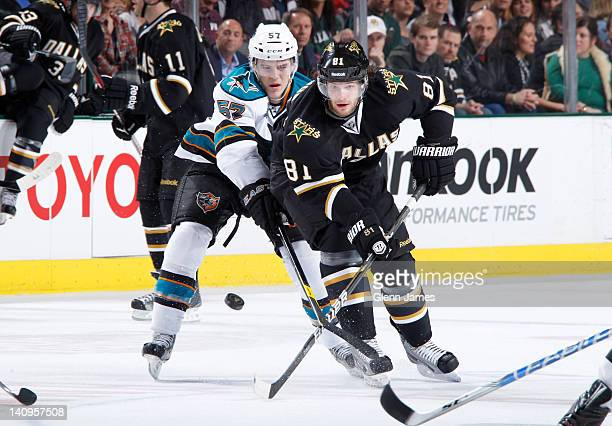 Tomas Vincour of the Dallas Stars handles the puck against Tommy Wingels of the San Jose Sharks at the American Airlines Center on March 8 2012 in...