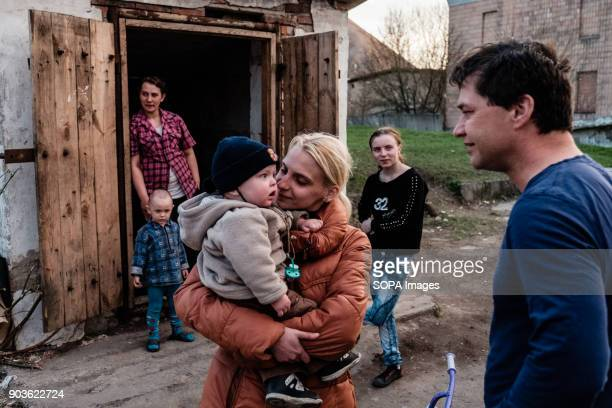 Tomas Vlach emergency coordinator for the NGO 'People in Need' welcome by some members of families living in the bunker The conflict between the...
