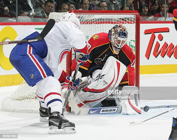 Tomas Vokoun of the Florida Panthers gets the paddle down and makes a save against Saku Koivu of the Montreal Canadiens at the Bell Centre on October...