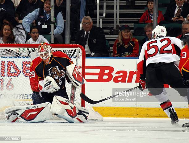 Tomas Vokoun of the Florida Panthers makes the save on Colin Greening of the Ottawa Senators at the BankAtlantic Center on March 10 2011 in Sunrise...