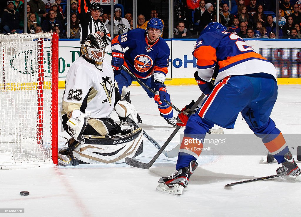 Tomas Vokoun #92 of the Pittsburgh Penguins defends the net against Josh Bailey #12 and Kyle Okposo #21 of the New York Islanders in an NHL hockey game at Nassau Veterans Memorial Coliseum on March 22, 2013 in Uniondale, New York. The Penguins defeated the Islanders 4-2.