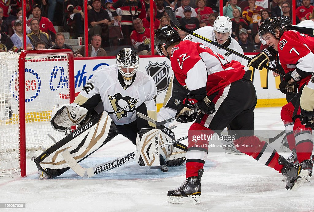 Tomas Vokoun #92 of the Pittsburgh Penguins makes a save against Erik Condra #22 of the Ottawa Senators as Kyle Turris #7 of the Ottawa Senators looks on in Game Three of the Eastern Conference Semifinals during the 2013 NHL Stanley Cup Playoffs, at Scotiabank Place, on May 19, 2013 in Ottawa, Ontario, Canada.