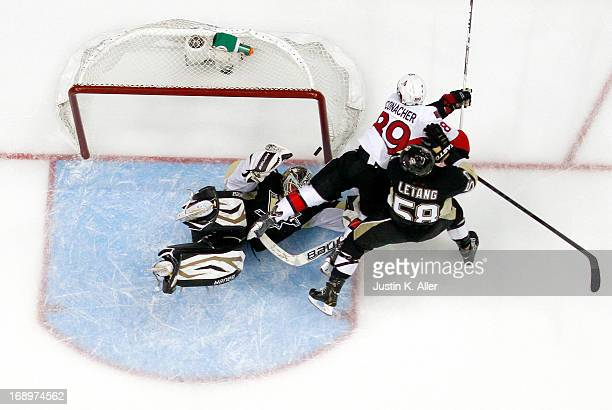 Tomas Vokoun of the Pittsburgh Penguins makes a save on Cory Conacher of the Ottawa Senators in Game Two of the Eastern Conference Semifinals during...