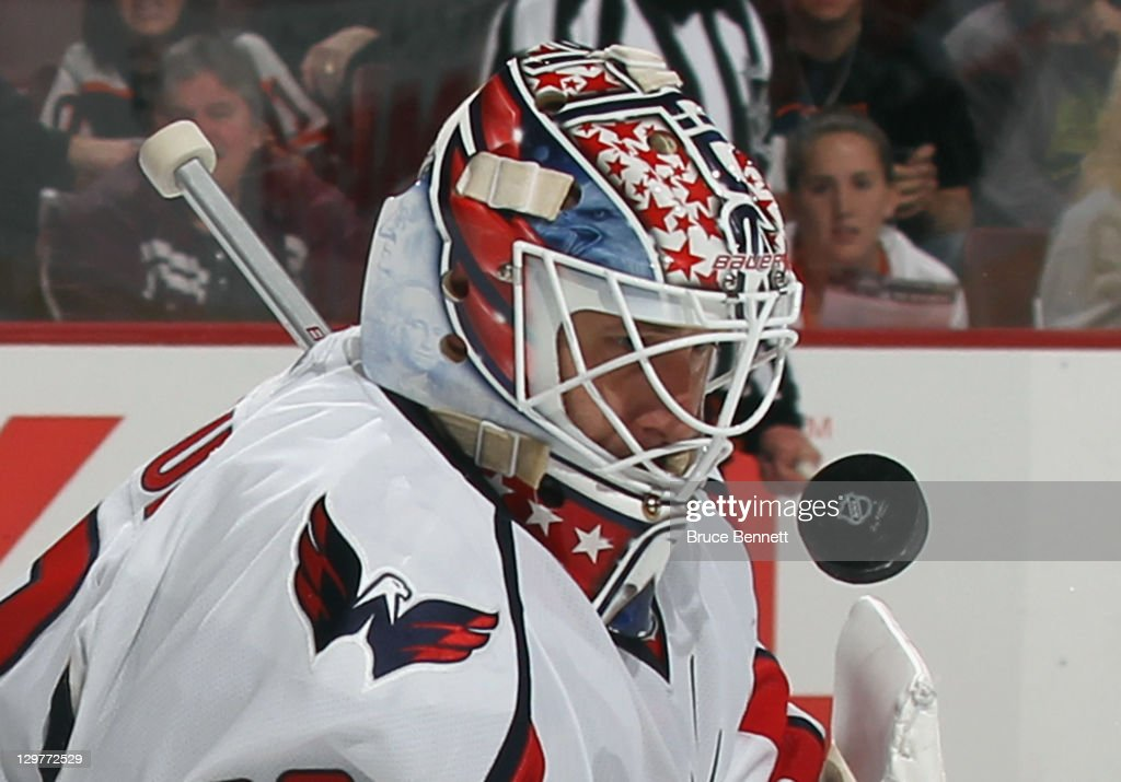 Tomas Vokoun #29 of the Washington Capitals keeps his eye on the puck after a second period save against the Philadelphia Flyers at the Wells Fargo Center on October 20, 2011 in Philadelphia, Pennsylvania.