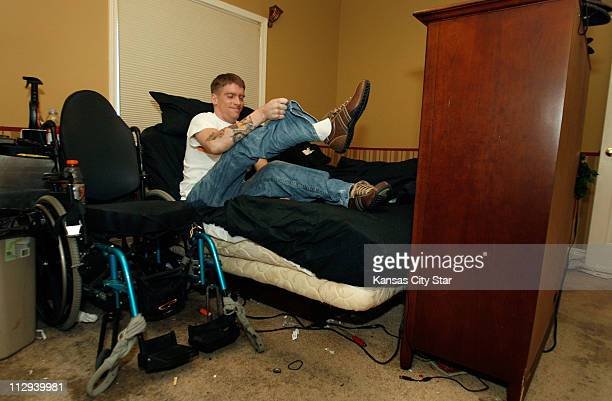 Tomas Young gets into bed October 16 at his Kansas City Missouri home Getting in and out of bed is one of the more trying problems with his...