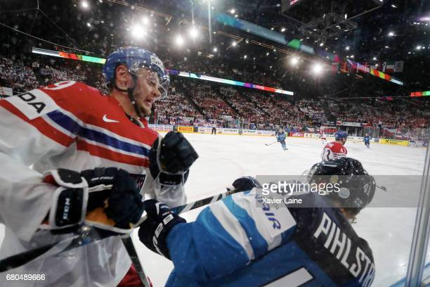 Tomas Zohorna of Czech Republic slash Antti Pihlstrom of Finland during the 2017 IIHF Ice Hockey World Championship game between Finland and Czech...