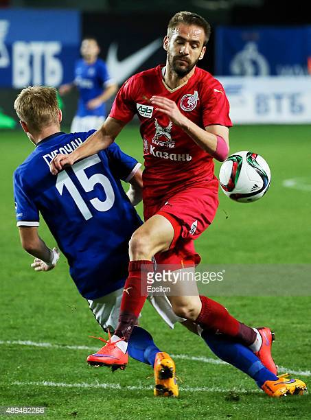 Tomash Hubochan of FC Dinamo Moscow is challenged by Marko Devic of FC Rubin Kazan during the Russian Premier League match between Dinamo Moscow and...