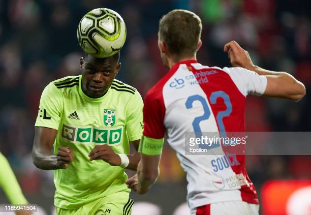 Tomash Soucek of FC SK Slavia Praha and Gigli Ndefe of MFK Karvina vie for the ball during the Czech First League match between SK Slavia Praha and...