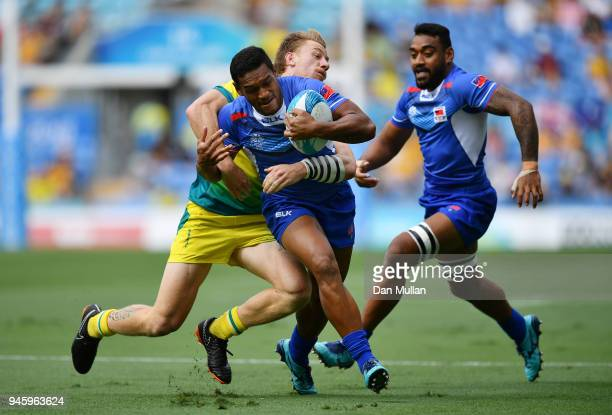 Tomasi Alosio Logotuli of Samoa is tackled by Ben O'Donnell of Australia during Rugby Sevens Men's Pool B match between Australia and Samoa on day 10...