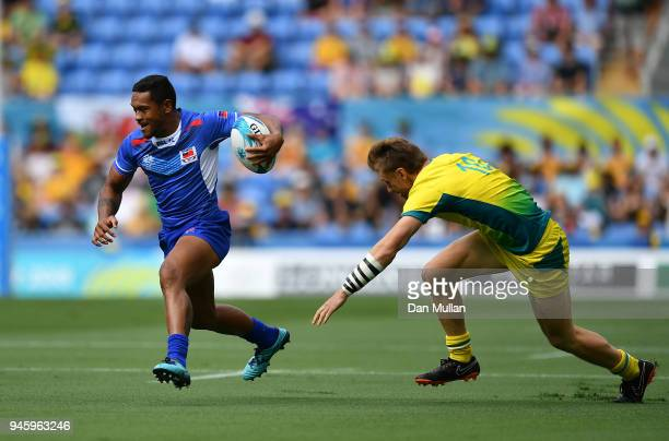 Tomasi Alosio Logotuli of Samoa makes a break past Ben O'Donnell of Australia during Rugby Sevens Men's Pool B match between Australia and Samoa on...