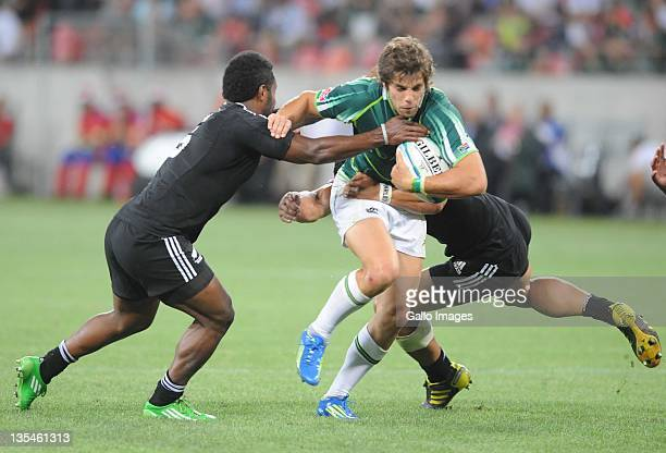 Tomasi Cama and Solomon King of New Zealand tackle Steven Hunt of South Africa during the final between South Africa and New Zealand on day two of...