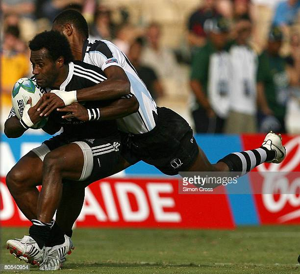 Tomasi Cama of New Zealand is tackled in the Semi Final during day two of the 2008 Adelaide Sevens held at Adelaide Oval April 6 2008 in Adelaide...