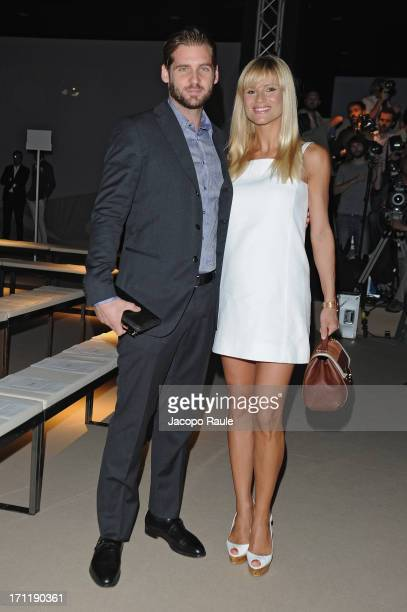 Tomaso Trussardi and Michelle Hunziker attend the Trussardi show during Milan Menswear Fashion Week Spring Summer 2014 on June 23 2013 in Milan Italy