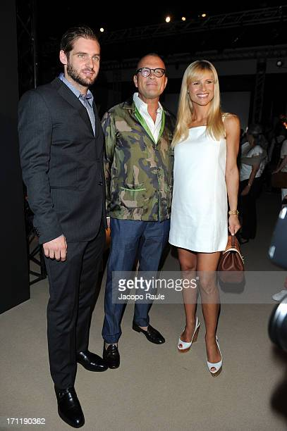 Tomaso Trussardi Cesare Cunaccia and Michelle Hunziker attend the Trussardi show during Milan Menswear Fashion Week Spring Summer 2014 on June 23...