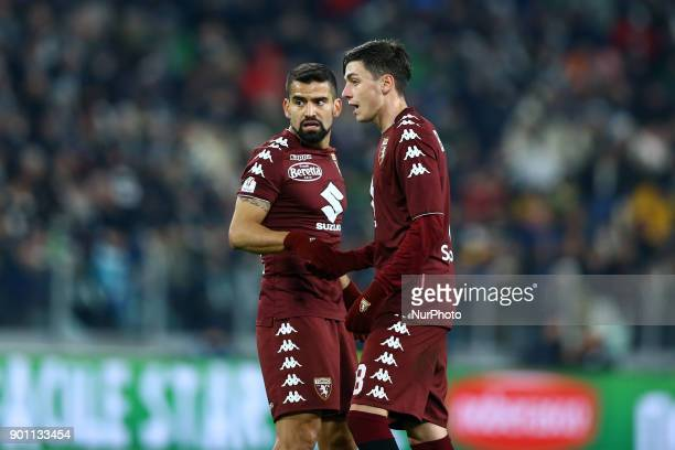 Tomass Rincon and Daniele Baselli of Torino during the TIM Cup match between Juventus and Torino FC at Allianz Stadium on January 3 2018