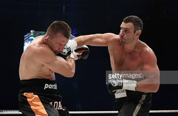 Tomasz Adamek of Poland and Vitali Klitschko of Ukraine exchange punches during the WBC Heavyweight World Championship fight between Vitali Klitschko...