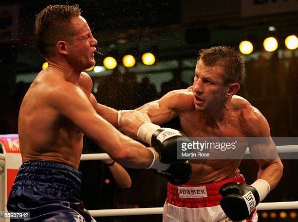 Tomasz Adamek of Poland knocks Thomas Ulrich of Germany in the 6th round out during the WBC Light Heavyweight Championship bout at the Dusseldorfer...