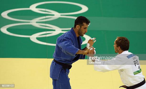 Tomasz Adamiec of Poland competes against Arash Miresmaeili of Iran in the judo event during day 2 of the Beijing 2008 Olympic Games at the...