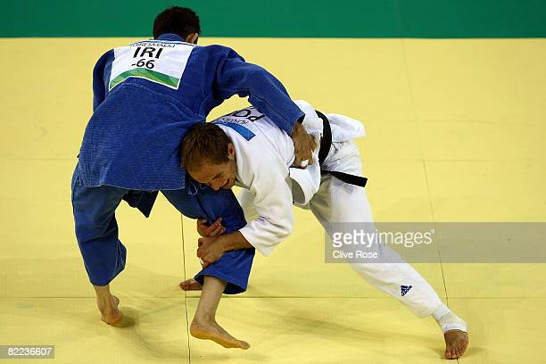 Tomasz Adamiec of Poland competes against Arash Miresmaeili of Iran in their 66 kg men's preliminary judo event during day 2 of the Beijing 2008...