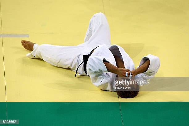 Tomasz Adamiec of Poland reacts against Arash Miresmaeili of Iran in their 66 kg men's preliminary judo event during day 2 of the Beijing 2008...
