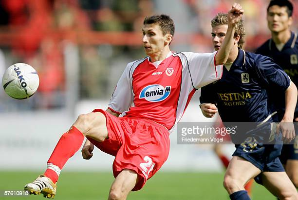 Tomasz Bandrowski of Cottbus challenges for the ball with Daniel Baier of 1860 during the Second Bundesliga match between Energie Cottbus and 1860...