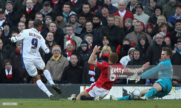 Tomasz Kuszczak and Wes Brown of Manchester United are unable to stop Jermaine Beckford of Leeds United scoring the opening goal during the FA Cup...
