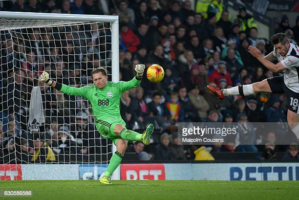 Tomasz Kuszczak of Birmingham City clears the ball ahead of Jacob Butterfield of Derby County during the Sky Bet Championship match between Derby...