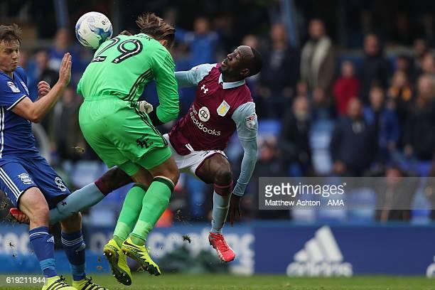 Tomasz Kuszczak of Birmingham City collides with Albert Adomah of Aston Villa during the Sky Bet Championship match between Birmingham City and Aston...