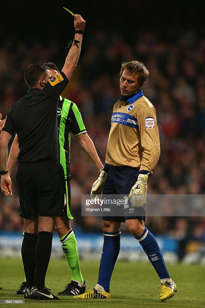 Tomasz Kuszczak of Brighton & Hove Albion is shown a yellow card by Referee M. Oliver during the npower Championship play off semi final first leg at Selhurst Park on May 10, 2013 in London, England.