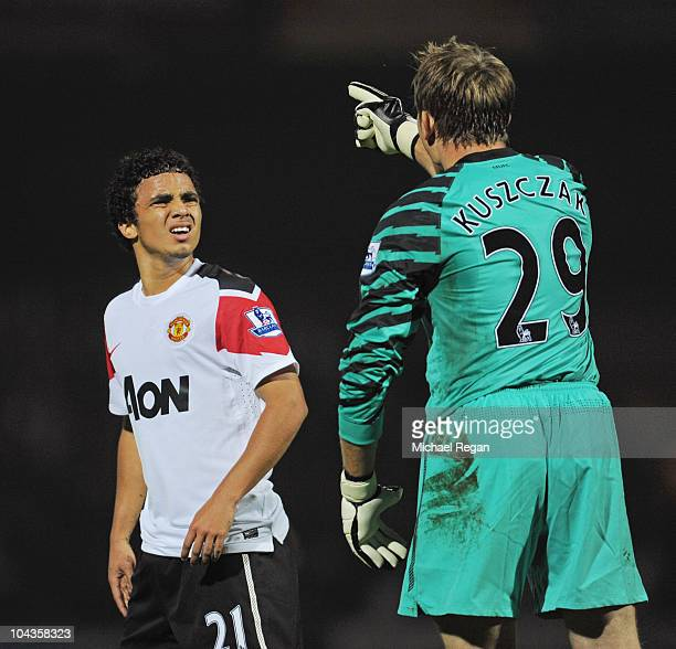 Tomasz Kuszczak of Manchester United argues with team mate Rafael after conceding the first goal during the Carling Cup 3rd Round match between...