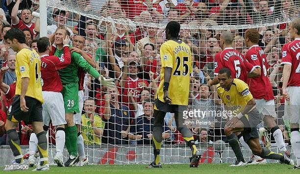Tomasz Kuszczak of Manchester United celebrates saving a penalty from Gilberto Silva of Arsenal during the Barclays Premiership match between...