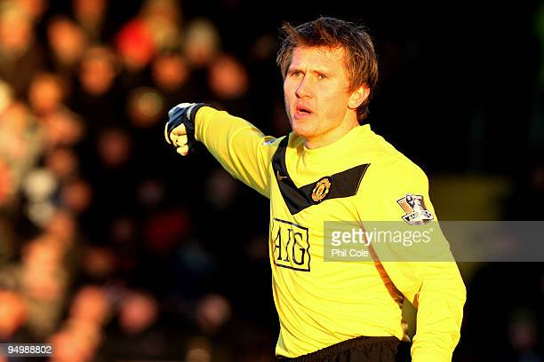 Tomasz Kuszczak of Manchester United directs his defence during the Barclays Premier League match between Fulham and Manchester United at Craven...