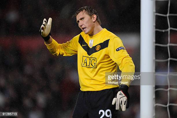 Tomasz Kuszczak of Manchester United gestures during the UEFA Champions League Group B match between Manchester United and VfL Wolfsburg at Old...