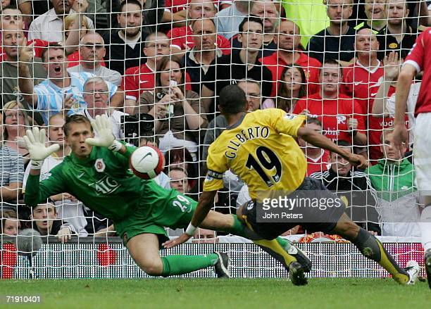Tomasz Kuszczak of Manchester United saves a penalty from Gilberto Silva of Arsenal during the Barclays Premiership match between Manchester United...
