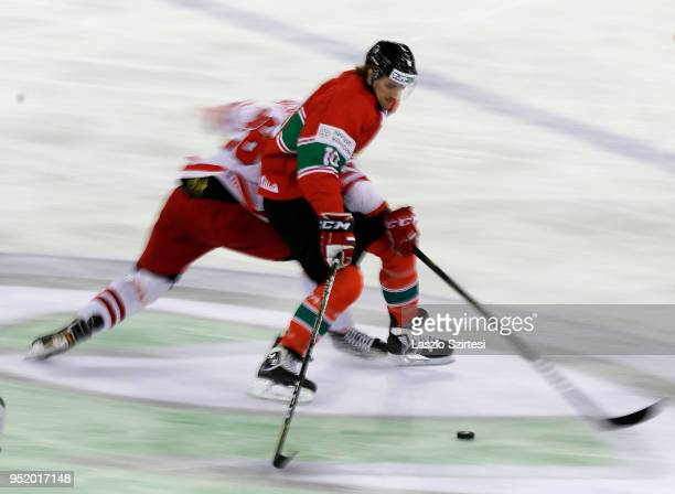 Tomasz Malasinski of Poland challenge Gergo Nagy of Hungary during the 2018 IIHF Ice Hockey World Championship Division I Group A match between...