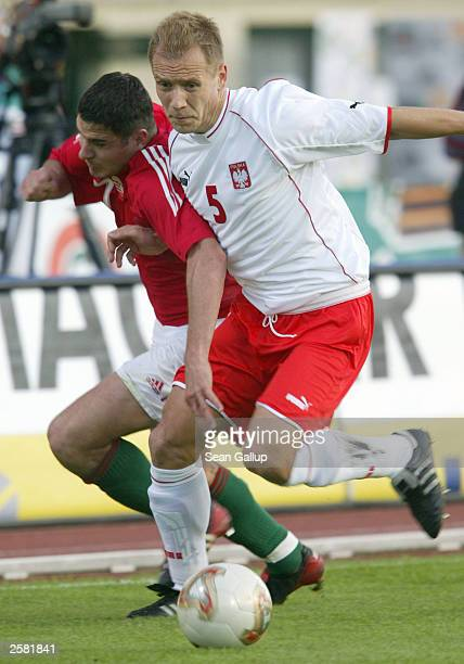 Tomasz Rzasa of Poland struggles with Imre Szabics of Hungary for the ball in their Euro 2004 soccer qualifying match October 11 2003 in Budapest...