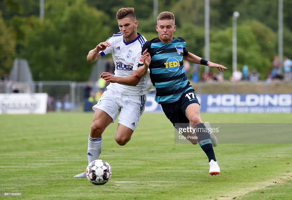 Tomasz Serwta of MSV Neuruppin and Maximilian Mittelstaedt of Hertha BSC during the game between MSV Neuruppin against Hertha BSC at the Volkspar-Stadion on july 12, 2018 in Neuruppin, Germany.