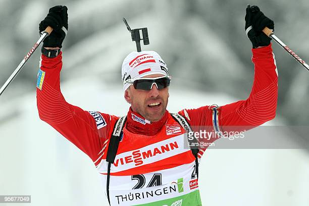 Tomasz Sikora of Poland celebrates after winning the Men's 15 km mass start in the e.on Ruhrgas IBU Biathlon World Cup on January 10, 2010 in...