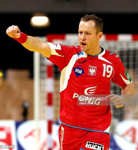 Tomasz Tluczynski of Poland celebrates during the Men's Handball European main round Group II match between Poland and Czech Republic at the Olympia...
