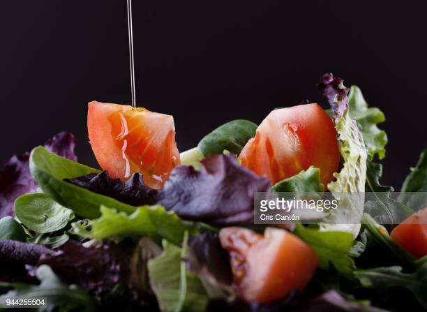 tomato and lettuce salad - cris cantón photography stock pictures, royalty-free photos & images