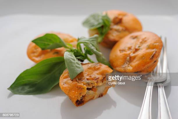 Tomato and mozzarella cakes with fresh basil