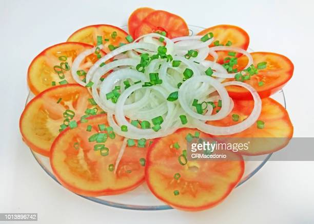 tomato and onion salad, with a little chive in the decoration - crmacedonio stock photos and pictures