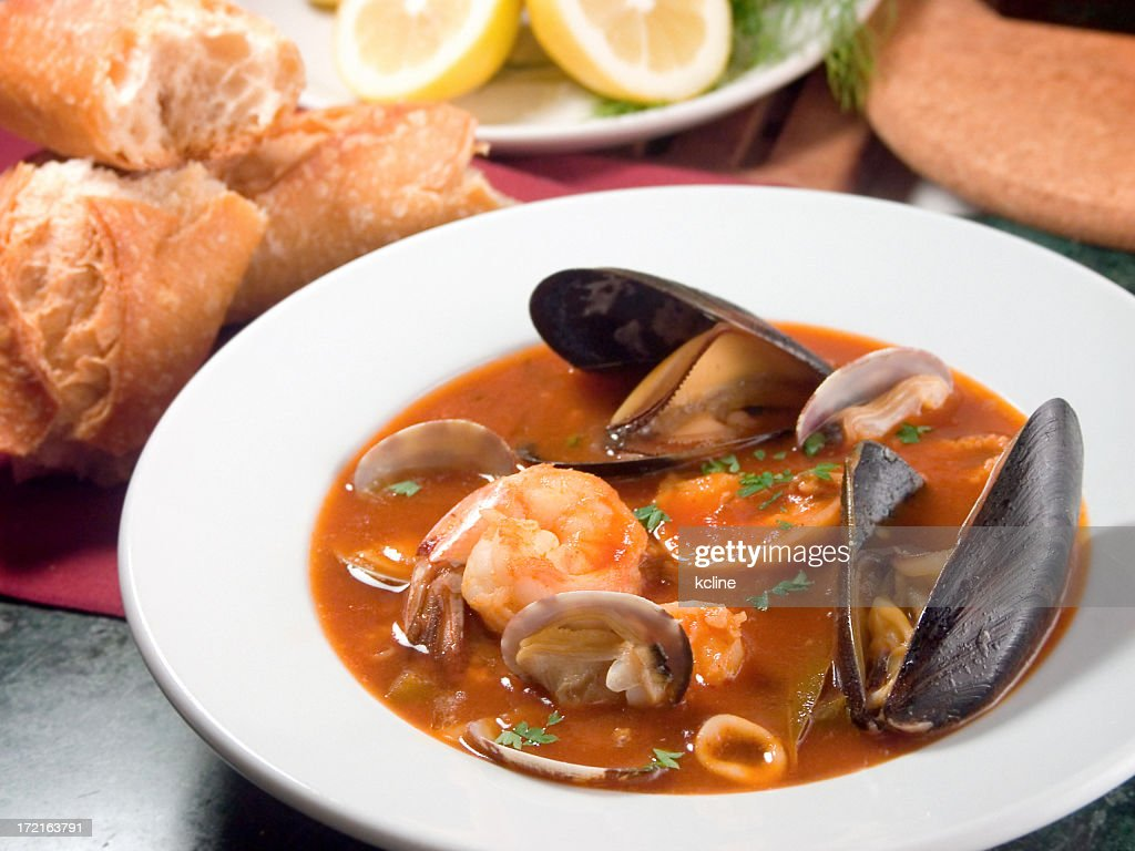 Tomato based soup in white bowl : Stock Photo
