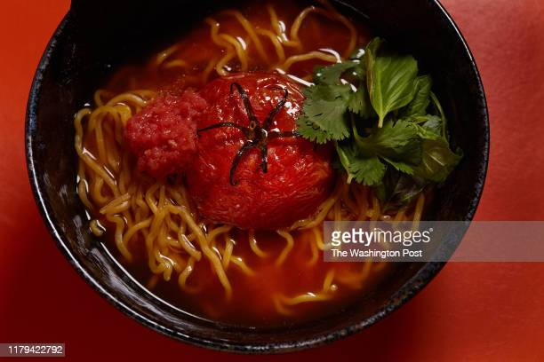 WASHINGTON DC OCTOBER Tomato Curry vegan ramen with roasted beefsteak tomato tomato oroshi extra virgin olive oil basil cilantro and nori...