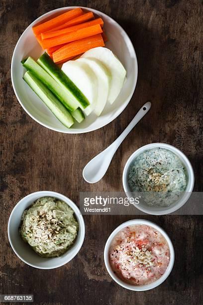 Tomato dip, avocado dip and herb dip and row food