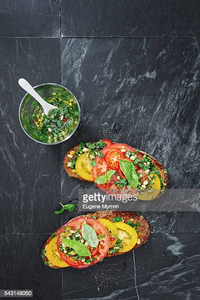 Tomato, harissa and green olive bruschetta